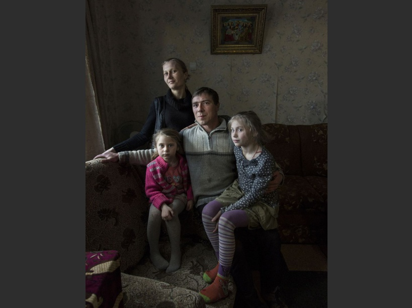 Nastia Natsik with her daughters Iuliana, Madina and Lia in her family house in Khristinovka. Lia, 2 suffers from a brain tumor. Her father, Emil, 37, fled the conflict in Abkhazia (Georgia) when he was eleven, 3 years after Chernobyl's disaster. Though evacuation was enforced in 1992 many families decided to stay. Khrystynivka, Cherkasy Province, UKRAINE - 13/03/2016./VALEROQUINTINA_UKR.055/Credit:Quintina Valero/SIPA/1604112020