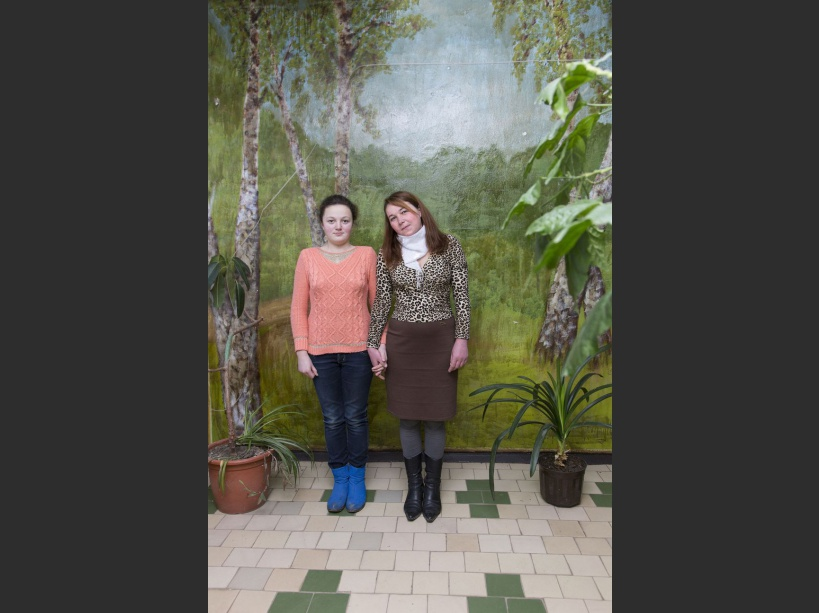 Olga and her mother Natasha posing for a picture at Narodichi's school where an NGO from Germany is visiting the area to check in children's health. Narodichi, UKRAINE - 26/02/2016./VALEROQUINTINA_UKR.017/Credit:Quintina Valero/SIPA/1604112020