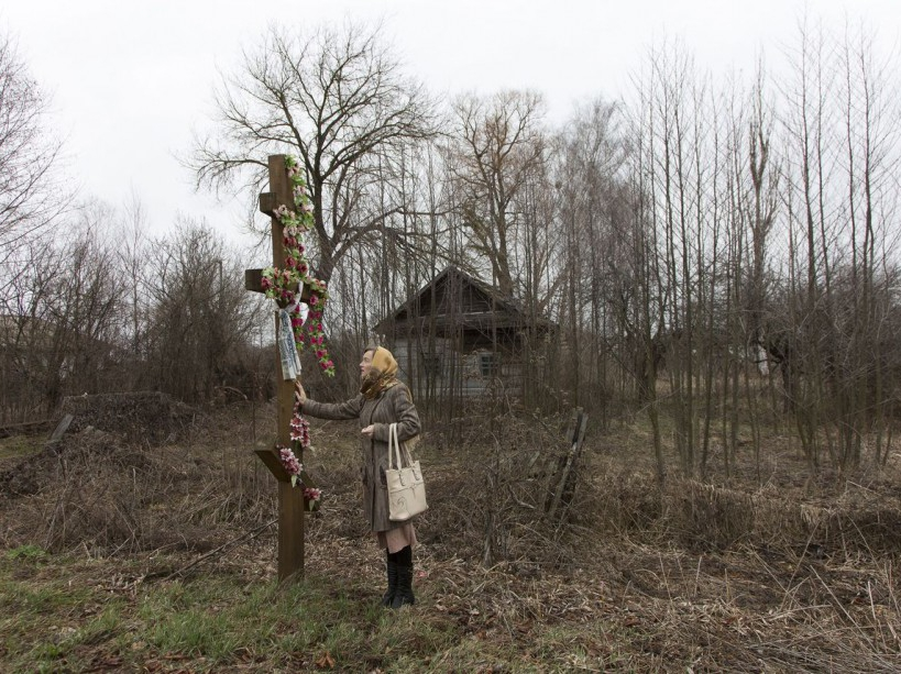 Natalia, school's teacher stands by the entrance of Maksimovichy village, where many houses were abandoned after Chernobyl's disaster. Narodichi district, UKRAINE - 12/03/2016./VALEROQUINTINA_UKR.050/Credit:Quintina Valero/SIPA/1604112020