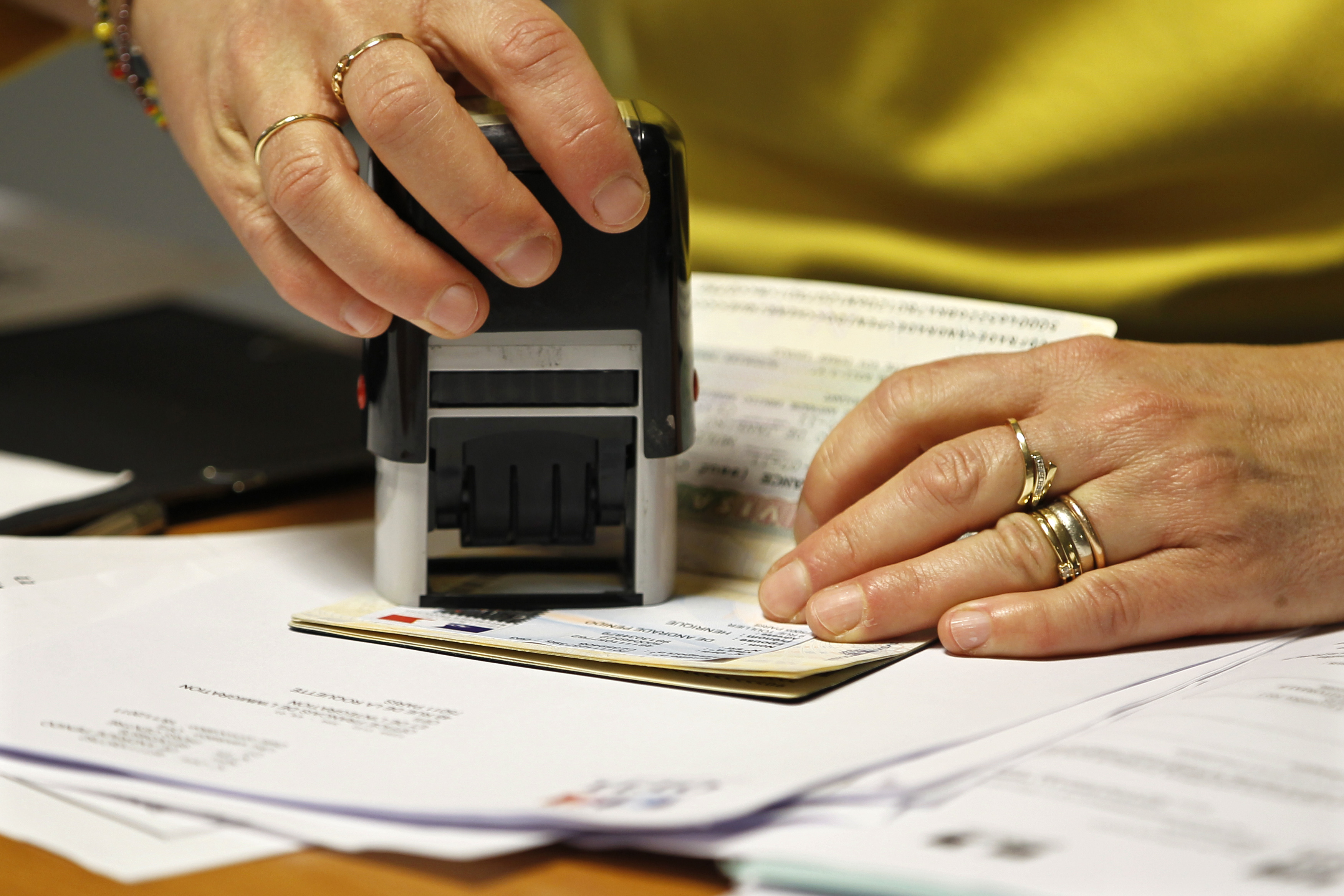An employee validates an extension visa on a foreign students